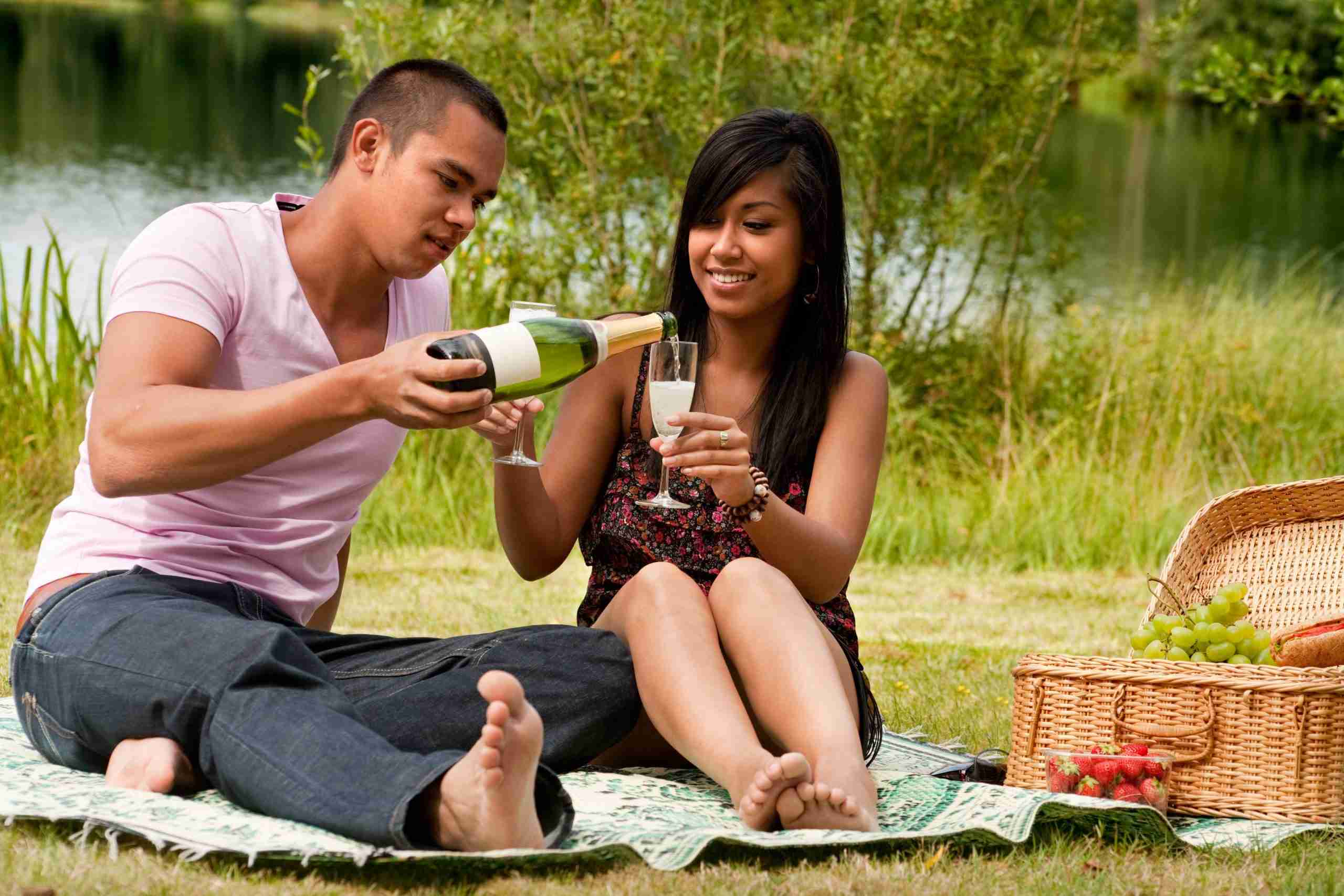 happy couple on picnic date